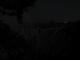 Ein sehr dunkles Foto der Victoriafaelle bei Vollmond